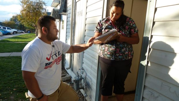 Ricardo Martinez, a volunteer for a non-partisan group that aims to mobilise voters, talks to Vanesa Rojas about the ...