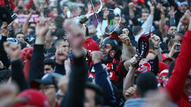 Jubilation: Wanderers fans celebrate the victory at Parramatta.