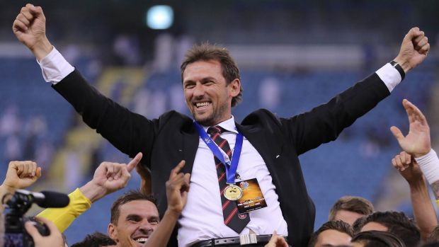 Western Sydney Wanderers players hold up their coach, Tony Popovic, as they celebrate their historic Asian Champions ...