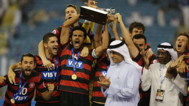 Canberra product Nikolai Topor-Stanley holds aloft the AFC Champions League trophy after leading the Wanderers to victory.