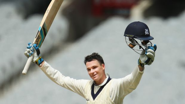 Victoria's Peter Handscomb celebrates after reaching his century on Sunday.