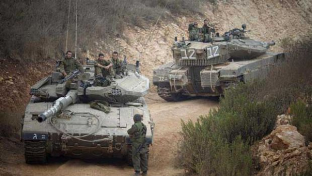 Israeli tanks near the site of an exchange of fire between Israeli and Lebanese troops.