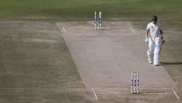 Lonely figure: Australian captain Michael Clarke is sent to the sheds after another disappointing innings.