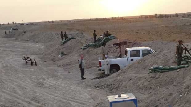 Local tribal fighters dig in against Islamic State militants in the town of Amriyat al-Falluja in Anbar province.