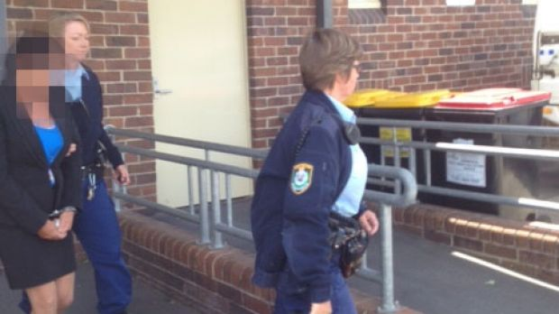 Police lead Betty Colt from Moss Vale Court as she is sentenced on Monday.