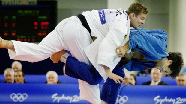Olympic heritage: Dan Kelly puts his American opponent in a hold during their judo clash in the Sydney 2000 Olympics.