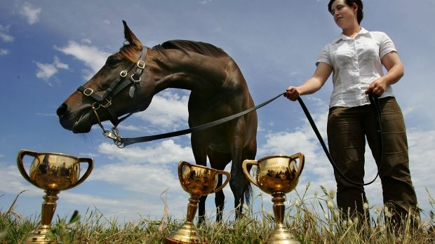 Makybe Diva after her third Melbourne Cup win with strapper Christine Mitchell in November 2, 2005.
