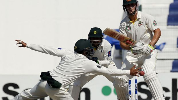 At full stretch: Azhar Ali reaches for a shot from Mitchell Marsh on the fifth day of the second Test.