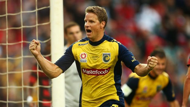 Bitter split: Former Mariners stalwart celebrates his goal in the 2013 A-League grand final.