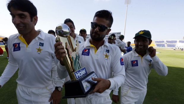 Ahmed Shehzad holds the trophy after Pakistan claimed victory.