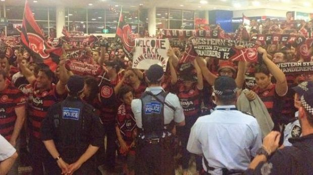 Proud bunch: Wanderers fans in the arrivals hall.