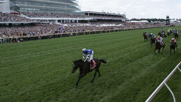 Protectionist, with Ryan Moore in the saddle, streaks away from his rivals to win the Melbourne Cup.