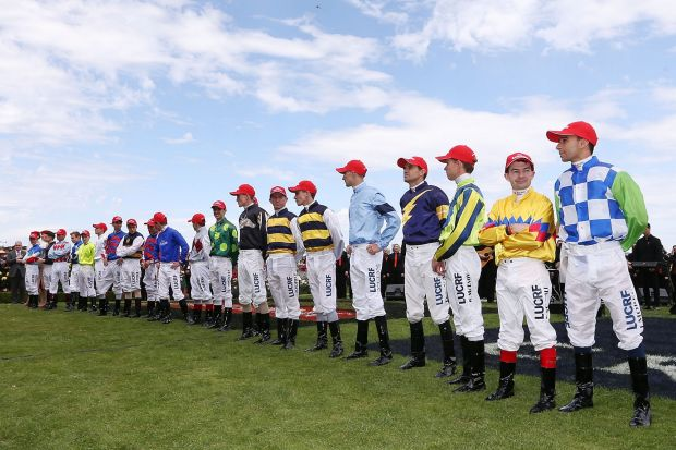 Jockeys in the mounting yard before the Cup.
