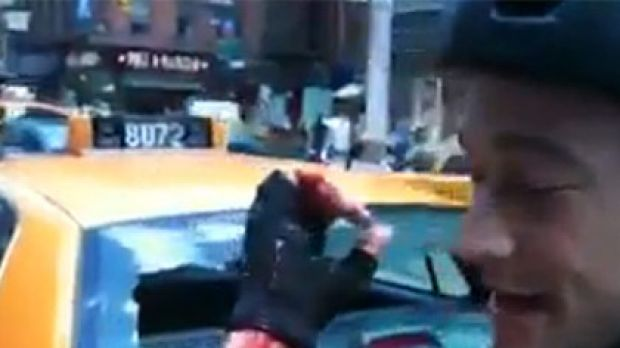 The actor shows off his injury after smashing through the cab's rear windscreen.