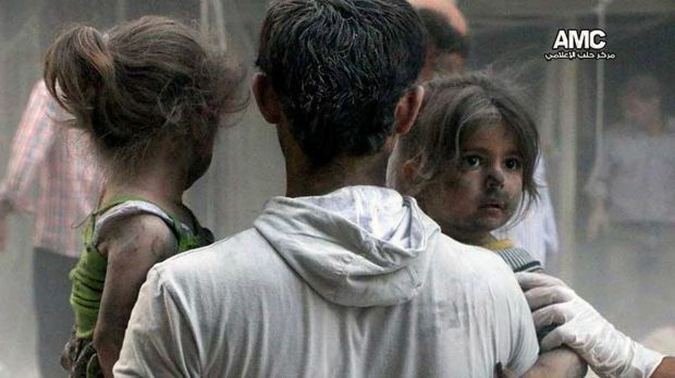 This image from a rebel media service shows Syrian children being rescued from a building hit by a regime air strike in ...
