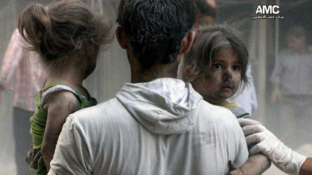 Syrian children are rescued from a building hit by a regime air strike in the Shaar district of Aleppo.