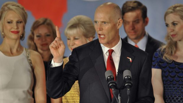 Republican Florida Governor Rick Scott celebrates his re-election in a deadlocked race against Democrat Charlie Crist ...