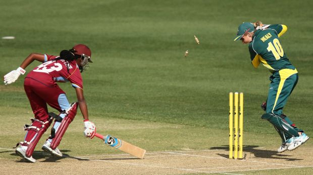 Shaquana Quintyne is found short of the crease by Australia's Alyssa Healy.