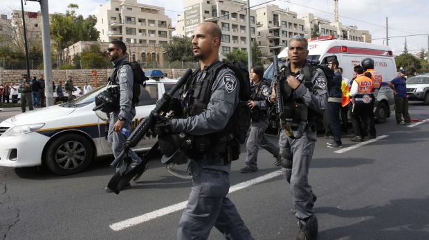 Israeli police officers head to the scene of the attack.