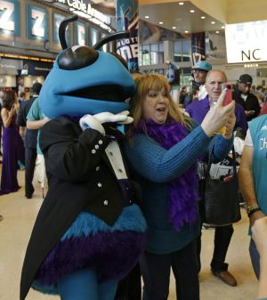 Selfie time: A fan takes a snap alongside Hugo the Hornet.