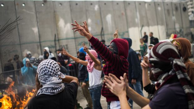 Palestinian youths clash with Israeli police in the Shuafat refugee camp, after a resident of the camp was named as the ...