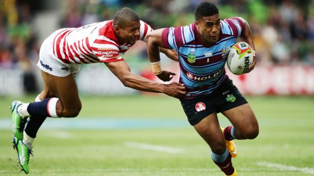 Slippery customer: Michael Jennings escapes the clutches of England's Kallum Watkins last weekend.
