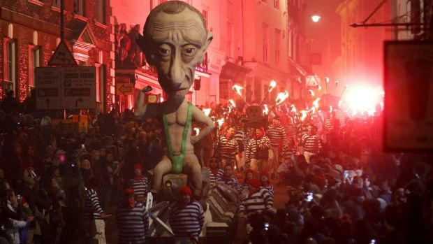 Remember, remember, the fifth of November: An effigy of Russian President Vladimir Putin is paraded through Lewes, England.