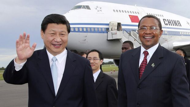 Chinese President Xi Jinping waves next to his Tanzanian counterpart Jakaya Kikwete, right, upon his arrival in Dar es ...
