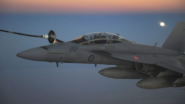 Service queried: A RAAF F/A-18F Super Hornet receives fuel from a RAAF tanker in the skies over Iraq.