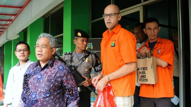 Neil Bantleman and Ferdinant Tjiong leaving the police station to be transferred to prison in November 2014.