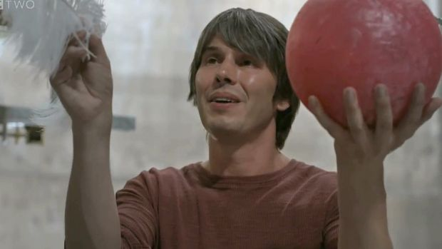BBC presenter Brian Cox drops  a bowling ball and a feather in NASA's Space Simulation Chamber in an experiment to see ...