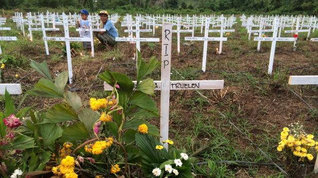 Crosses mark the graves of 2600 people buried in Tacloban's Holy Cross Memorial Gardens.