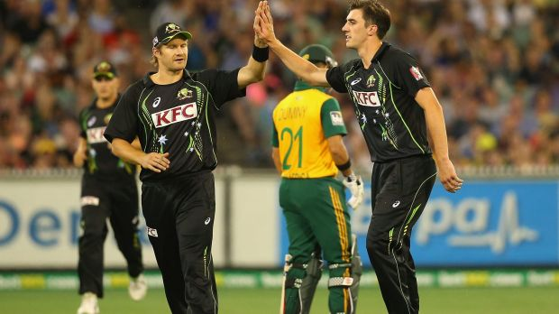 Talent: Pat Cummins (right) is congratulated by Shane Watson.