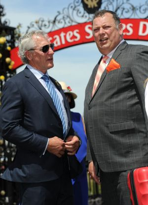 Trainer Mike Moroney (r) chats with owner Rupert Legh after the presentation for the Antler Luggage Handicap.