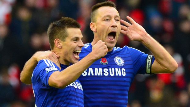 Cesar Azpilicueta and John Terry celebrate a 2-1 win over Liverpool at Anfield.