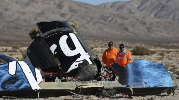 Police look at wreckage at the Virgin Galactic SpaceShipTwo crash site near Cantil, California on November 2.