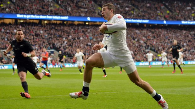 Wonderful try: England winger Jonny May leaves the All Blacks cover defence floundering.