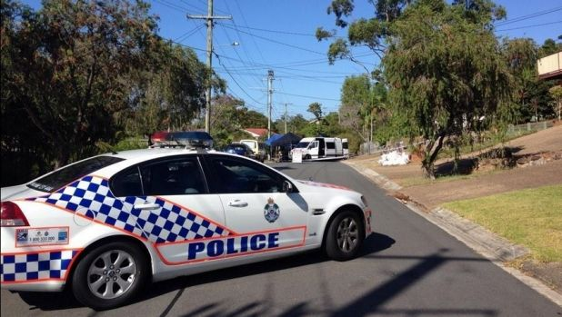 Police and emergency services on Kallista Road at Rochedale South, where military grade explosives were found inside a house.