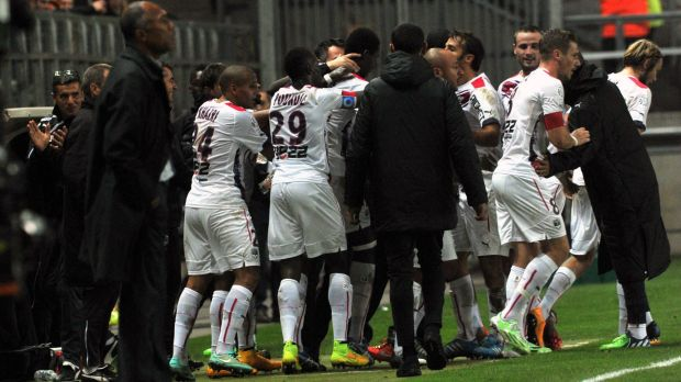 Cheick Diabate celebrates his goal with teammates and coach Willy Sagnol.