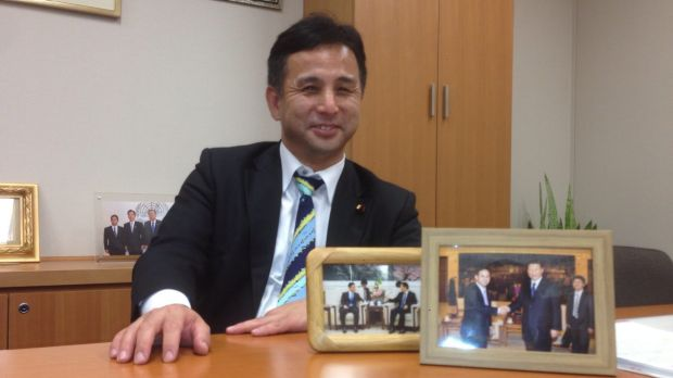 Mending fences: Kiyohiko Toyama at his office in Tokyo, with framed pictures of his meetings with Chinese President Xi ...