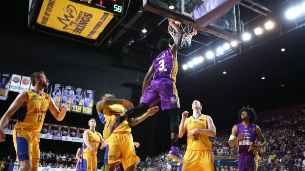 Flying high: Kendrick Perry dunks on the Adelaide 36ers.
