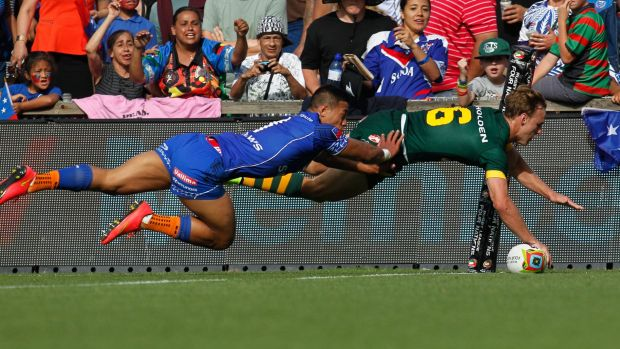 Hands-on: Daly Cherry-Evans scores in the corner for the Kangaroos against Samoa.
