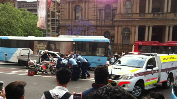 Police subdue a man on George Street, outside Town Hall, on Monday afternoon.