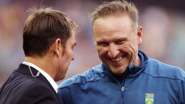 Shane Warne speaks to former South Africa speedster Allan Donald at the first T20 game between Australia and South ...