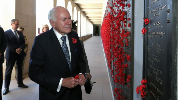 Paying tribute: Former prime minister John Howard lays a poppy at the Afghanistan Roll of Honour during the Remembrance ...