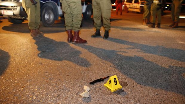 Israeli soldiers stand near a knife at the scene of a stabbing attack at the settlement of Alon Shvut in the ...