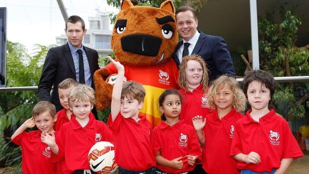 Added spice: Australia's Asian Cup mascot Nutmeg the wombat meets Cup ambassdors Brett Emerton (left), Mark Bosnich and ...