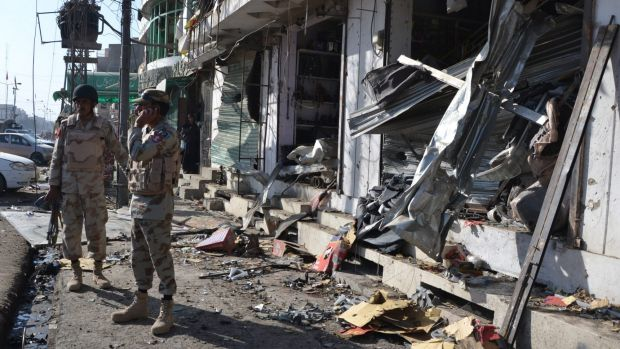 Pakistani para-military troops inspect the site of a bomb blast in Quetta, Pakistan.