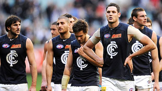 Carlton players show their disappointment after their loss to Collingwood last Saturday.