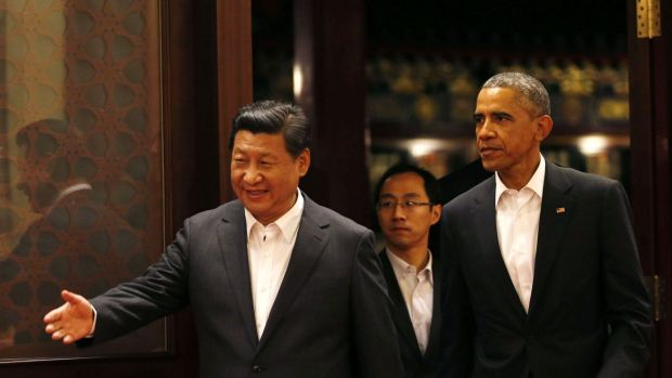 Polite host: China's President Xi Jinping and US President Barack Obama at the Asia Pacific Economic Co-operation summit ...